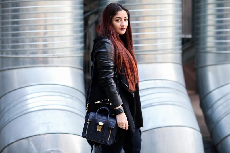 veste noire manches en cuir